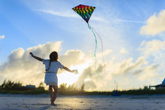 Little girl flying a kite Royalty Free Stock Photography