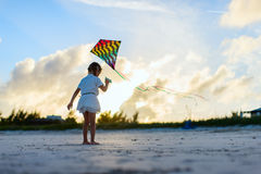 Little girl flying a kite Royalty Free Stock Images