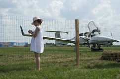 Little girl and flying machine, raw Royalty Free Stock Image