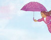 Little girl flying in open air with umbrella Stock Images