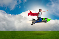 The little girl flying rocket in superhero concept Royalty Free Stock Photography
