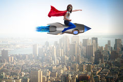 The little girl flying rocket in superhero concept Stock Photos