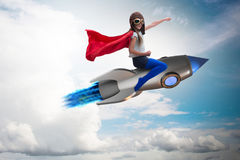 The little girl flying rocket in superhero concept. Little girl flying rocket in superhero concept Stock Photos