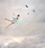 Little Girl Flying at Twilight. Little Blonde Girl Flying with Butterflies at Twilight stock photography