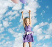 Little girl flying up to the sky Stock Image