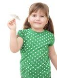 Little girl flys the plane Stock Images