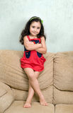 Little girl and folded arms Royalty Free Stock Photography