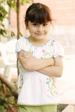 Little girl with folded hands Royalty Free Stock Images