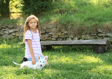 Little girl stroking a puppy Stock Photography