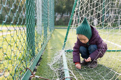 Little girl on a fooball pitch Stock Photography
