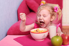 Little girl with food Royalty Free Stock Image