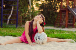 Little girl football player Royalty Free Stock Photo