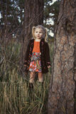 Little girl in forest. Beautiful little girl exploring through forest Stock Photography