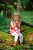 Little girl in the forest Stock Photos
