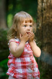 Little girl in the forest Stock Image