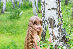 Little girl in the forest. Royalty Free Stock Photo