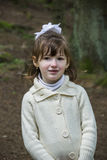 Little girl in forest Stock Image