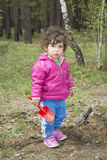 Little girl in the forest. Stock Photo