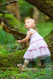 Little girl in the forest Stock Photo