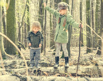 Little girl in the forest with her sister Stock Photography