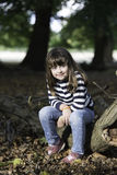 Little girl in the forest Royalty Free Stock Photography