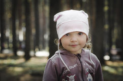 Little girl in the forest Royalty Free Stock Image
