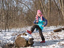 Little girl in the forest in wintertime Stock Images