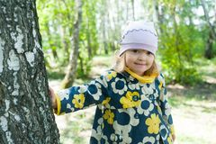 Little girl in forest Stock Photo