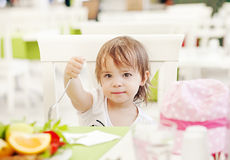 Little girl with fork Royalty Free Stock Images