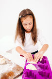Little girl forming sweet cakes, white background Stock Image
