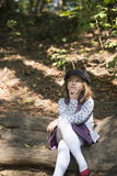 Little girl in the forrest Stock Images