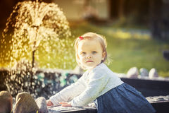 Little girl and fountain Stock Photography