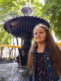 The Little Girl and Fountain. Little girl traveler and fountain royalty free stock image