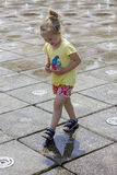 Little girl at the fountains. Little girl playing at the fun fountains Royalty Free Stock Photos