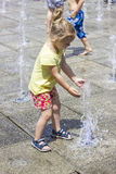 Little girl at the fountains. Little girl playing at the fun fountains Stock Photography