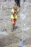 Little girl at the fountains. Little girl playing at the fun fountains Stock Images