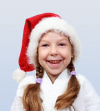 The little girl of four years with a cap on his head santa claus Stock Images
