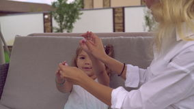 Little girl four years old laughing smiling playing with mother. Caucasian child enjoy sunny day outdoors have fun with adult lady. Baby and female wearing in stock video