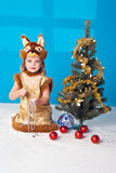 Little girl in Fox (Squirrel) suit near NY tree Stock Images