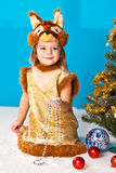 Little girl in Fox (Squirrel) suit near NY tree Stock Photography