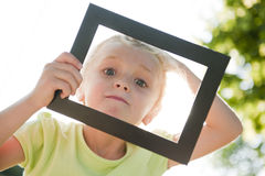 Little girl in frame Royalty Free Stock Image