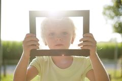 Little girl in frame Stock Photos