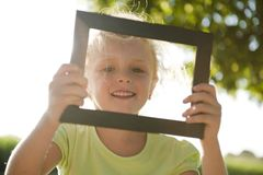 Little girl in frame Stock Photography