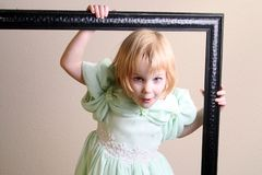 Little girl in a frame Stock Image