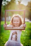 Little girl and frame stock images