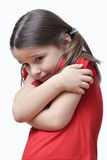 Little Girl Freezing. Cute little girl hugging herself as if freezing. Clipping path included Royalty Free Stock Photography