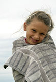 Little girl freezing but smiling. Little girl smiling from the towel and freezing Stock Photography
