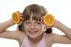 Little girl with fresh orange Stock Photo