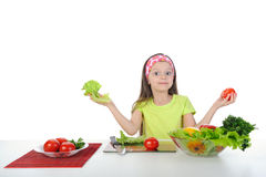 little girl with fresh vegetables. Stock Photo