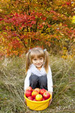 Little girl with fresh vegetables in garden Royalty Free Stock Images